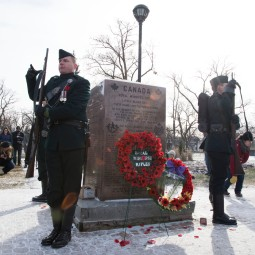 Members of The Royal Winnipeg Rifles are relieved from their post in front of the Rifles Memorial after the service.