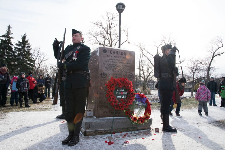 Members of The Royal Winnipeg Rifles are relieved from their post in front of the Rifles Memorial after the Remembrance Day service at Vimy Ridge Park.