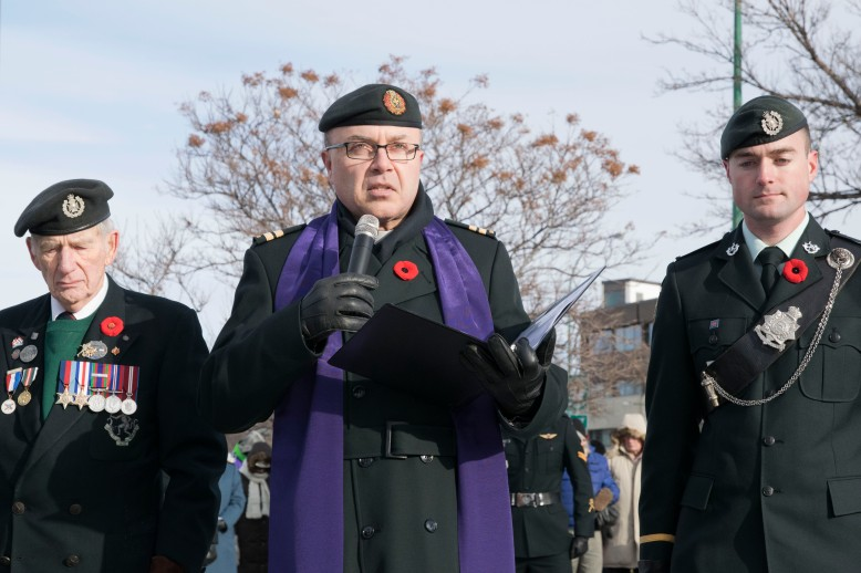 A member of The Royal Winnipeg Rifles delivers sprayer during the service.