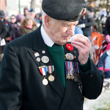 A Second World War Veteran and member of The Royal Winnipeg Rifles gets emotional during the service.