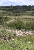 Debris from a house that was destroyed in Waywayseecappo First Nation is scattered throughout a valley. The house was pushed off its foundation at the top of a hill on Monday during a tornado-producing storm. (Eva Wasney/The Brandon Sun)